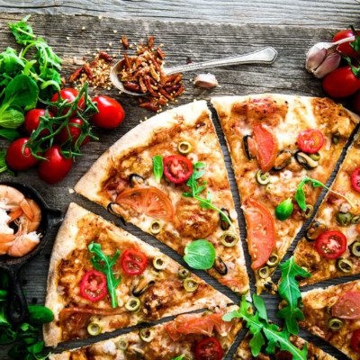Although the basics of pizza stay the same, toppings and types vary greatly.