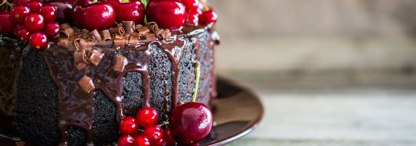 Cake is obtained from a chemically leavened batter that results in a spongy and airy texture.