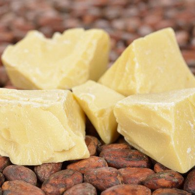 Cocoa butter is a saturated fat obtained from cocoa tree beans.