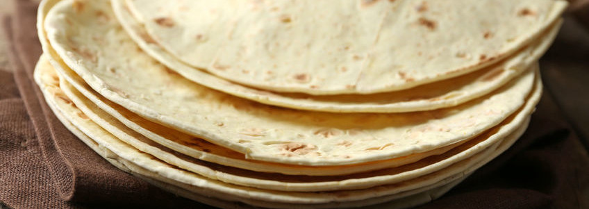 Tortillas are flat, thin, light-colored, round breads.