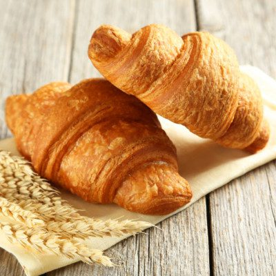 A croissant is a laminated, yeast-leavened bakery product with a flaky, crispy texture.