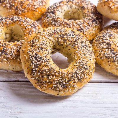 A bagel is characterized by a shiny, tough crust and a chewy crumb.