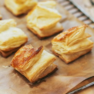 A puff pastry is a very delicate and rich pastry that consists of many thin alternating layers of dough and fat.