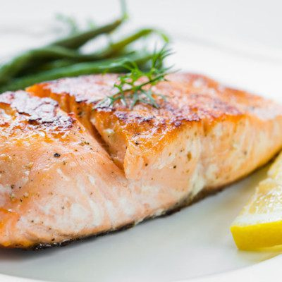 A fish allergy stems from an allergic reaction to a protein called parvalbumin found in a wide variety of finned fishes such as salmon.