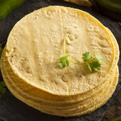 "Corn tortillas are a round, thin, unleavened bread made with coarse masa flour or ""flourless"" fresh masa."
