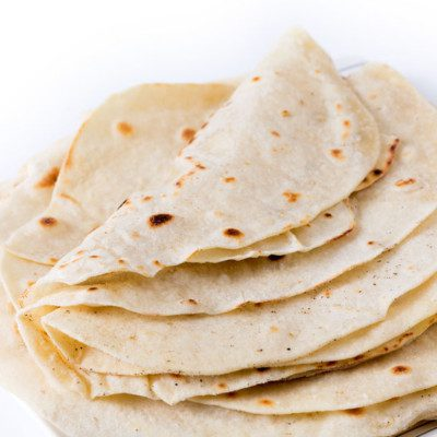 Flour tortillas are flat and circular breads used as the base for traditional Mexican foods such as tacos, burritos, quesadillas and enchiladas.