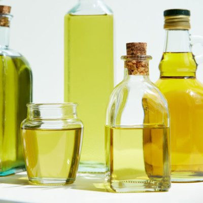 Oil is a plant-derived fat that remains liquid at room temperature and is made up of a mixture of triglycerides.