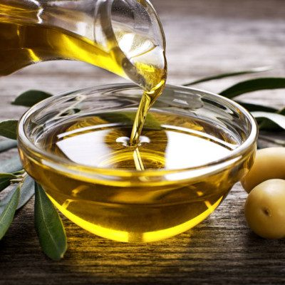 Olive oil is a fat extracted from whole olives.