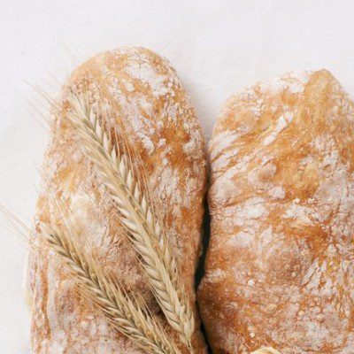 Italian bread is a hearth-baked product leavened with commercial baker's yeast or based on sourdough.