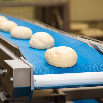 Dough moulding is the final step of the makeup stage in high-speed production of pan or loaf-type bread.
