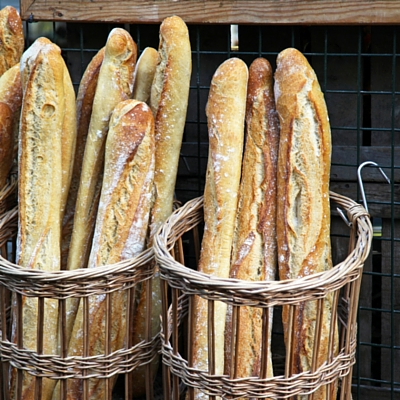 A baguette is characterized by a crisp crust and chewy texture inside.