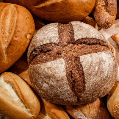 Scoring bread gives a variety of patterns on the top crust and helps with development.